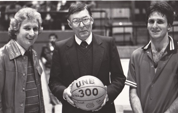 In this Dec. 8, 1981, photo, University of New Brunswick Red Raiders men's basketball coach Don Nelson receives a signed ball commemorating his 300th win. He's joined by UNB president Dr. James Downey, left, and Red Raiders star Scott Devine.