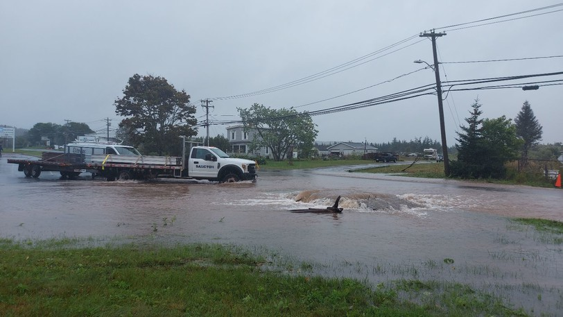 A stretch of Bayside Drive, pictured here, was one of several roads closed Thursday as the Saint John region was blanketed by heavy rainfall.