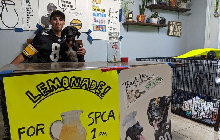 Kyle Kennedy inside his Moncton home with Loki, a two-year-old Eurohound who is every bit the Pittsburgh Steelers fan his master is.