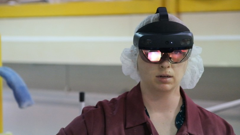 Software designed by the company Kognitiv Spark uses Microsoft HoloLens headsets to layer holograms onto the field of view, allowing experts to accompany industrial workers in the field remotely.