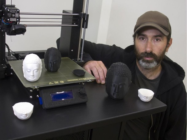 aAron Munson will be 3D printing thousands of Buddha heads as he meditates over the next month.
