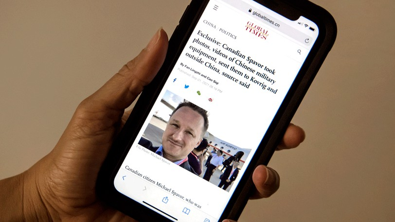 A story on the Global Times website about Canadian Michael Spavor's case is seen on an iPhone.