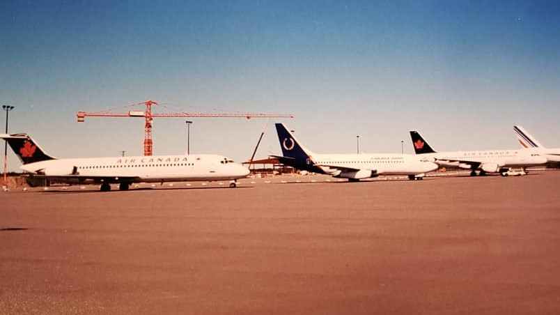 Airliners are seen parked at the Moncton airport on Sept. 11, 2001. In the background, a huge crane is working on the new terminal building, which was officially opened by Queen Elizabeth II on Oct. 19, 2002.