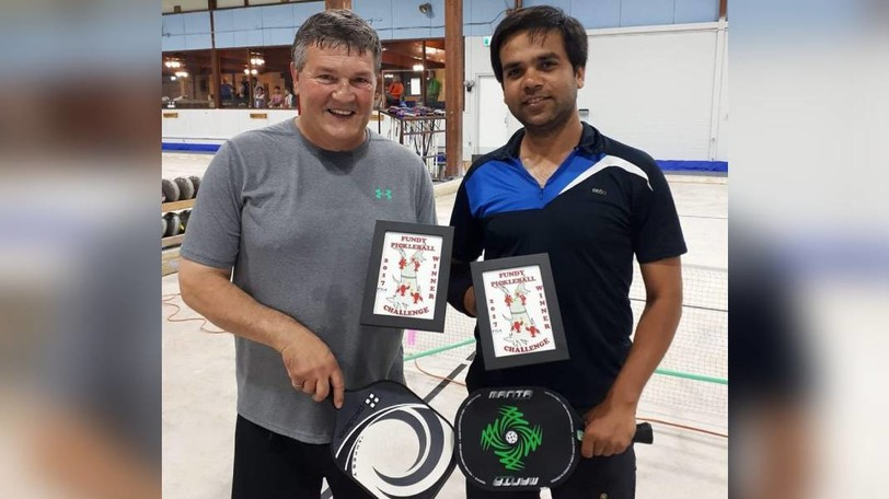 The late Bernard Robichaud is pictured with his friend Kumar Raghav, an organizer of the annual pickleball tournament that now bears his name.