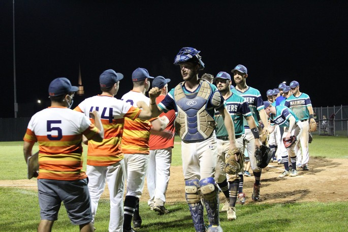 Catcher Corey Kavangh (right, foreground) leads the Justin Morehouse Exit Realty Mariners through the congratulatory handshake line after they defeated the Astros in the Capital City Intermediate Baseball League playoffs. Kavanagh and the Mariners face the Jack's Pizza Expos in the final game of the best-of-five championship series Tuesday night at 7 p.m. at Royals Field.