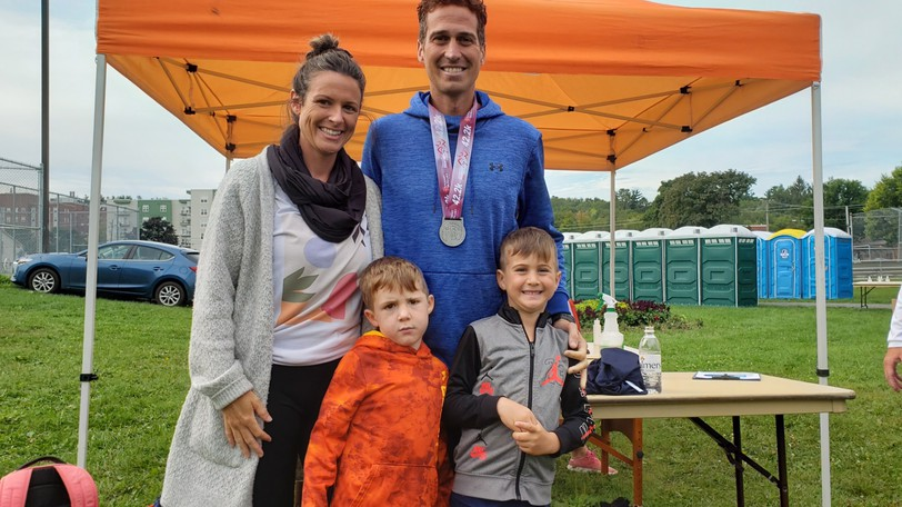 Stanley Chaisson celebrates with his family after winning the 43rd Stewart McKelvey Fredericton Marathon in a new race record time of 2:29:20. Celebrating with him were his wife, Marie-Michele Comeau, and sons Liam, front left, five, and Kaleb, six.