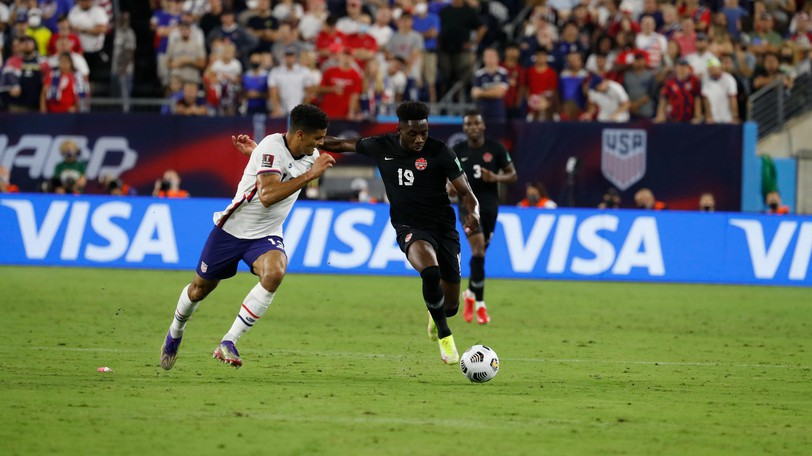 Canada's Alphonso Davies, left, contends with Miles Robinson of the U.S. men's national soccer team during a FIFA World Cup qualifying match Sept. 5 in Nashville, Tenn.
