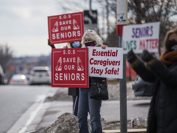 Protesters demonstrate in support of better care for long-term care residents in this file photo.