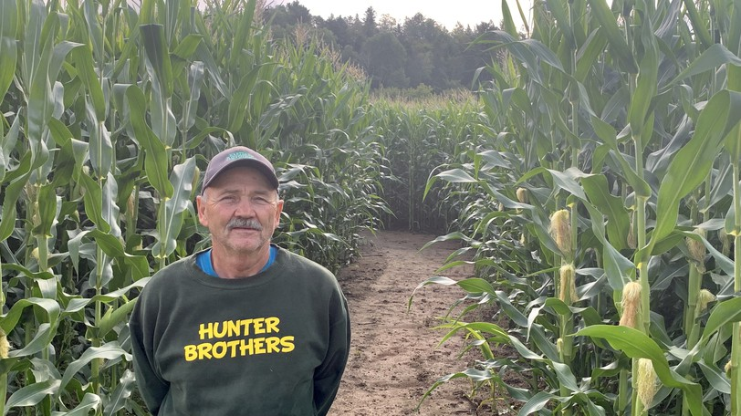 Chip Hunter of Hunter Brothers Farm stands at the entrance to this year's corn maze, which has the theme of the Bluenose ship.