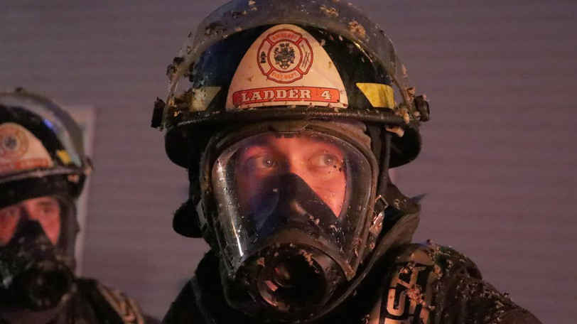 Firefighters from the Amherst Fire Departmentwere covered in insulation that had to be washed off their bunker gear after responding to an apartment building fire on Tuesday evening.