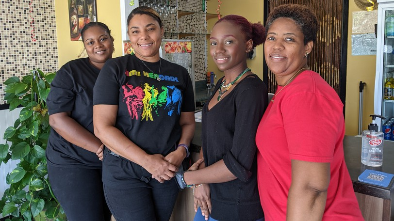 Staff at the Spicy Grillz Jamaican restaurant in Riverview are Shiekera Smith, Novelene Taylor, Deanan Walters and Hamerika MacNeil.