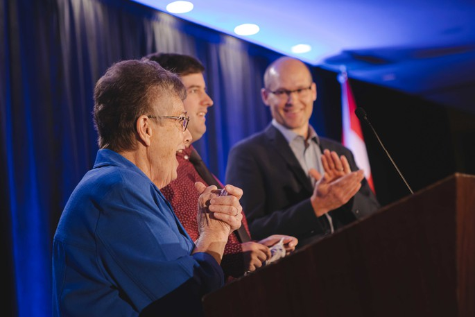 Mary Beth McCurdy, of the Sisters of Charity, catches Patrick McGrath and Kevin Belyea, of L'Arche Saint John, by surprise with a $100,000 donation to launch the non-profit's Brighter Futures Fund during a gala at the Delta Hotel Tuesday.