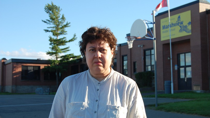 """Evelyne Godfrey, the federal NDP candidate for Beauséjour, is pictured Wednesday outside Marshview Middle School in Sackville, near the place where a man allegedly subjected her to a """"racist tirade"""" before puncturing a tire on her rented vehicle with a knife on Aug. 22, 2021."""