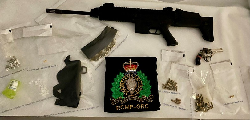 The RCMP seized drugs and firearms and arrested a man following an incident in Victoria Park on Tuesday.