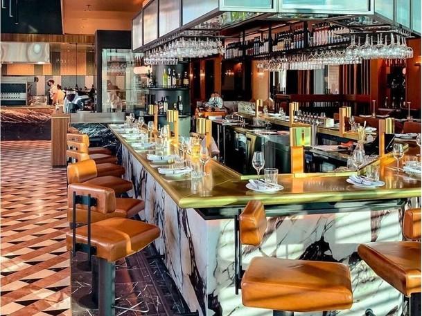 The Hiltons' Blandino Brasserie, serving rich, robust Italian cuisine,  was designed by the prestigious Atelier Zébulon Perron.