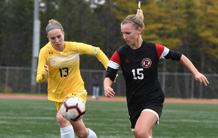 """UNB Reds' Jesse Bellamy, right, chases after a loose ball in 2019 playoff action against the Dalhousie Tigers. Atlantic University Sport student-athletes and other individuals will have to be fully vaccinated """"before setting foot on the field of play"""" this season, the AUS announced Thursday."""