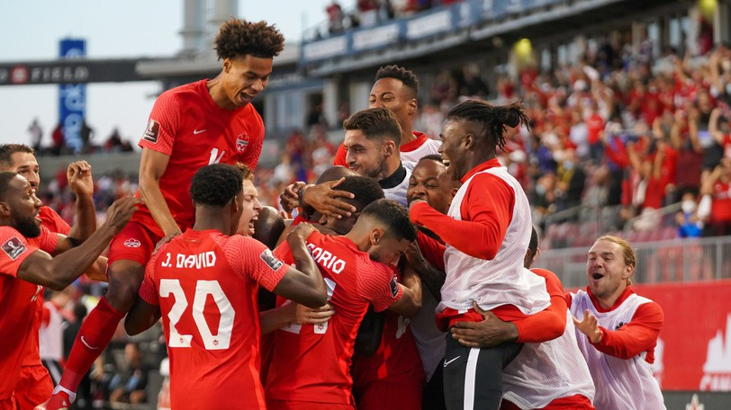Tajon Buchanan, top left, and the Canadian men's national soccer team celebrate a goal by Atiba Hutchinson in a 3-0 win over El Salvador in FIFA World Cup Qualifying Sept. 8 at BMO Field in Toronto.
