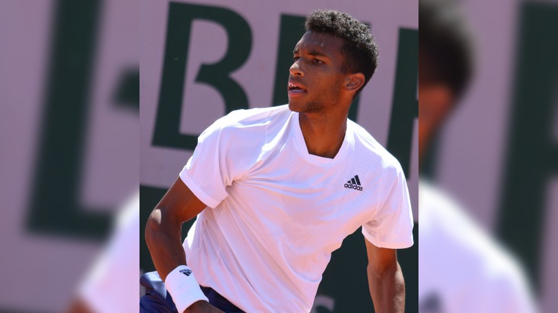 Felix Auger-Aliassime advanced to the semifinals of the U.S. Open with a win Tuesday over Carlos Alcarez, who was forced to retire with a leg injury.