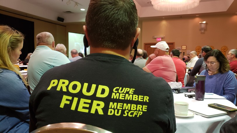 A union member listens to the CUPE leadership at a press conference in Fredericton last week, when they demanded a better deal from the provincial government.