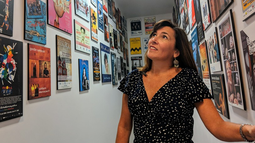 Kim Rayworth, managing director of the Capitol Theatre, looks at some of the show posters in a stairwell leading to the upstairs office in this file photo. The theatre unveiled its 2021/2022 programming season on Friday.