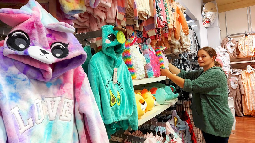 Store manager Claire Ellis stocks the girls' section in UKids, formerly known as Urban Kids, a new children's clothing store in Fredericton's Uptown Centre retail plaza.