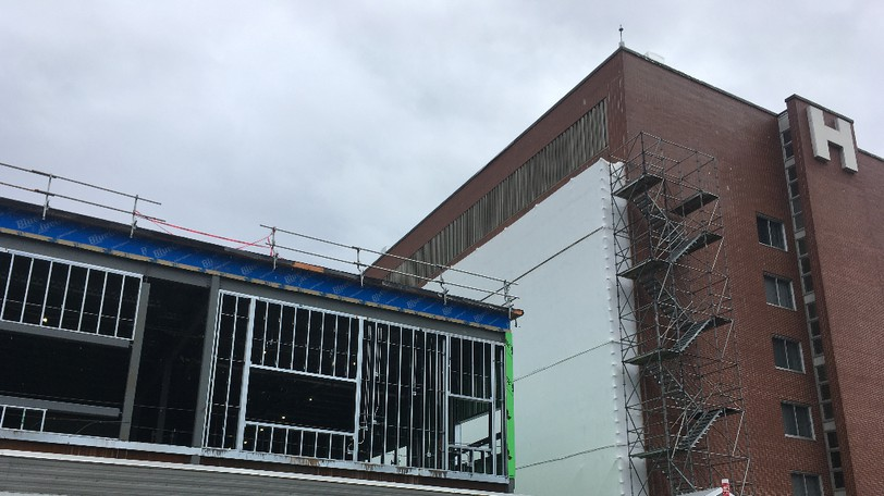 A tarpaulin covers the windows of a building adjacent to a construction site at The Moncton Hospital Friday, Sept. 10, 2021.