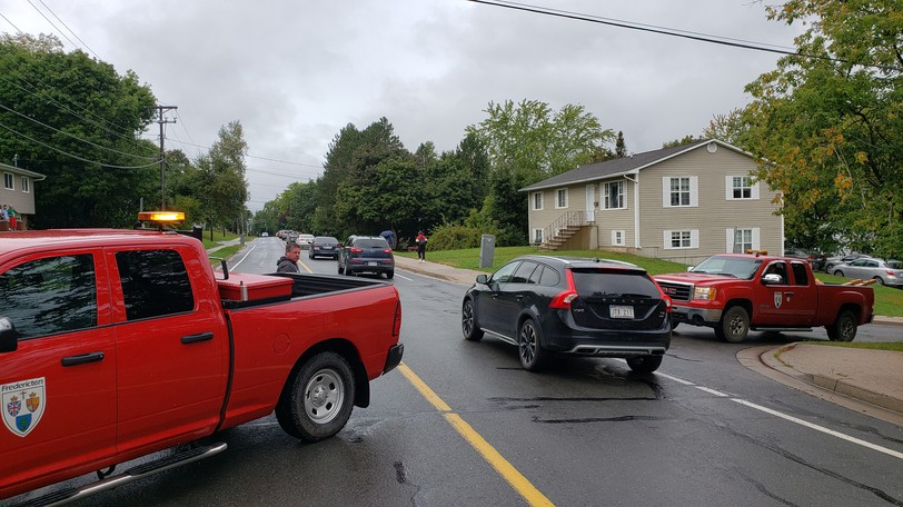 City of Fredericton workers helped authorities block off Kings College Road near UNB's campus Friday afternoon because of an unspecified threat.