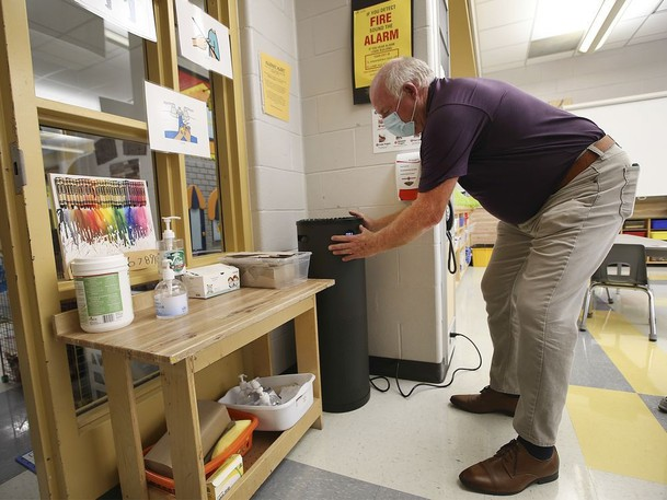 Unlike New Brunswick, Ontario is using portable air filters in classrooms to try and prevent the spread of COVID-19. In this photo, Steve LeBel, co-ordinator of maintenance with the Greater Essex County District School Board, checks out a HEPA air purification unit in a classroom at the Talbot Trail Public School in Windsor.