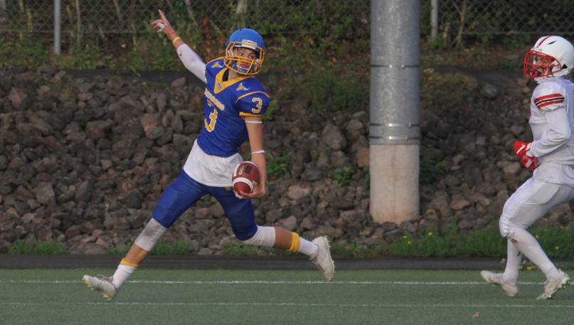Mathieu-Martin Matadors' Samuel Parent scores a touchdown against the St. Malachy's Saints during a New Brunswick High School Football League 12-aside AA division game on Friday at Rocky Stone Memorial Field.