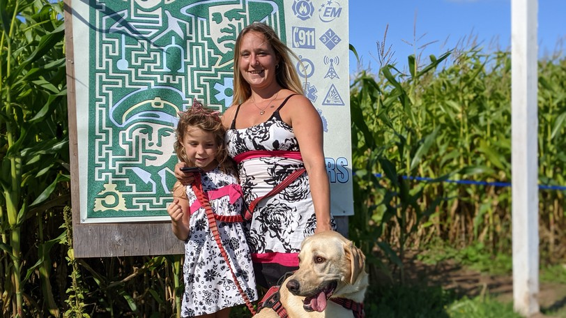 Jolene Riopel and her six-year-old daughter Audree took their dog Sasha through the corn maze at the Green Pig Country Market Saturday.