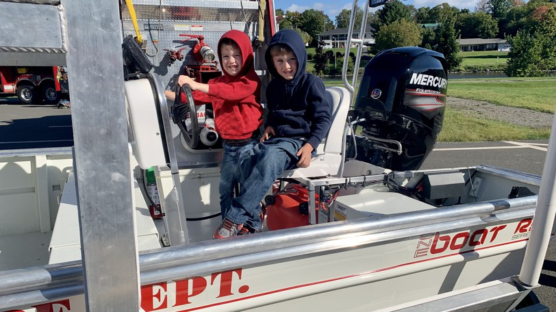 FaytHarrington, left,and Elijah Harrington try out Woodstock Fire Department's rescue boat during a Public Safety event at NBCC Woodstock on Saturday, Sept. 11.
