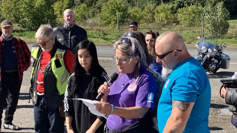 Ride 4 Suicide Awareness organizer Maria Pozsgai speaks to bikers gathered for the inaugural event about her nephew Jon, who passed away Feb. 4, 2020 after a battle with mental health.