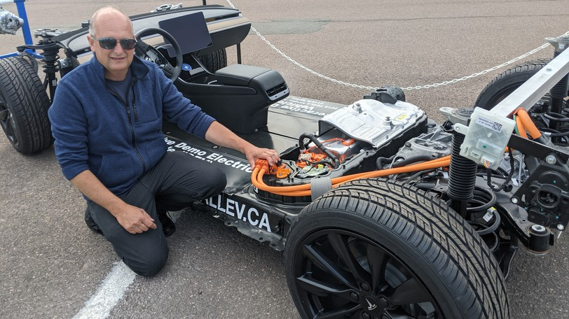 Dave Giles, an electric vehicle specialist with All-EVCanada in Dartmouth, shows a 2019 Tesla Model 3 electric car which has been stripped down to the frame and wheels to show the battery, charging system and motor.