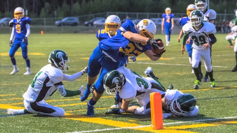 Ecole Sainte-Anne Castors' Henry Mason, shown diving into the end zone in this file photo, had a touchdown as the Castors opened the 2021 New Brunswick High School Football League season with a 27-22 win over the Bernice MacNaugton Highlanders at Scotiabank Park South.