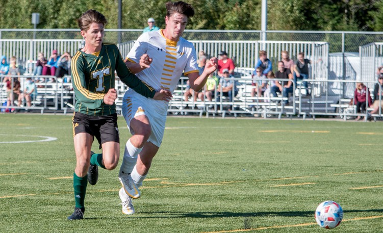 Brett Springer, left, of the STU Tommies fights off Sam Woodill of the Dalhousie AC Rams on his way to one of three goals in ACAA soccer action Saturday at Scotiabank Park South. The Tommies won 4-0.