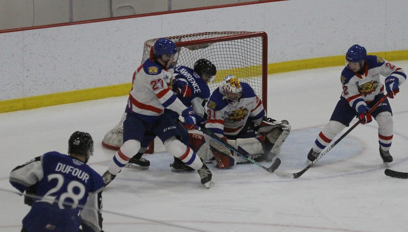 Saint John Sea Dogs' Josh Lawrence looks for a rebound as Moncton Wildcats goaltender Vincent Filion makes a save during QMJHL pre-season play on Sunday at Dieppe's UNIplex.