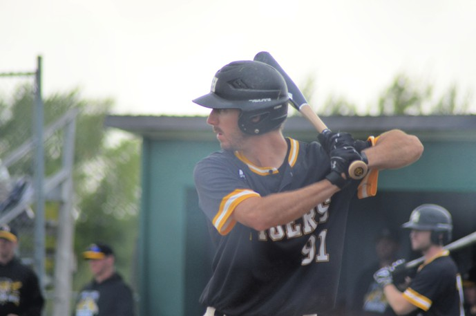 Kevin Losier and the host Chatham Head Tigers edged the Fredericton Jack's Pizza Expos 2-1 in their round-robin finale, but lost 4-0 to the Dieppe Cardinals in the semifinals Sunday at the New Brunswick Intermediate A Baseball Championships at Waldo Henderson Memorial Field.