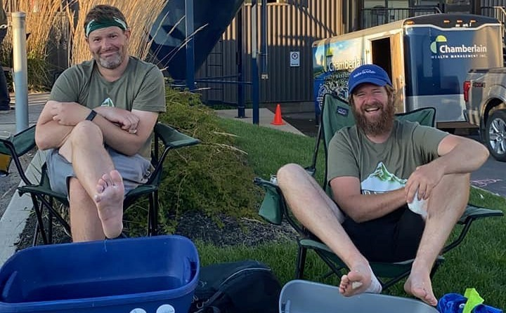 Adam Chamberlain, left, and Eric Scouten put up their feet Friday at Moosehead Small Batch Brewery in Saint John after completing their second annual River Valley Wish Walk. They walked more than 400 kilometres in eight days, raising $36,000 for Make-A-Wish Canada.