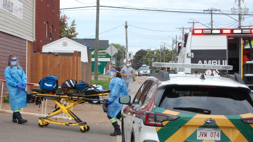 Emergency responders on Monday, Sept. 13, 2021, respond to a medical call at Harvest House, where Public Health previously declared a COVID-19 outbreak.