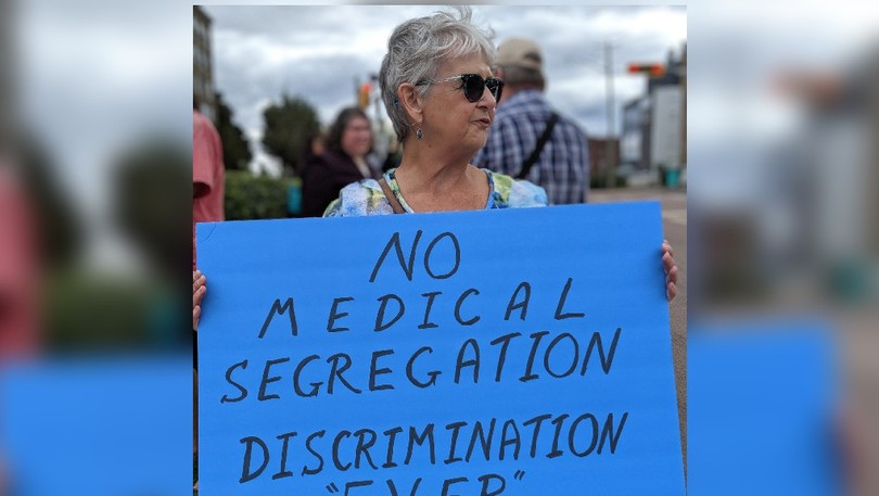 Sheilagh Price, one of dozens of protesters outside the Dr. Georges-L.-Dumont University Hospital Centre on Monday. The group was speaking out against mandatory COVID-19 vaccinations as well as vaccination passports.