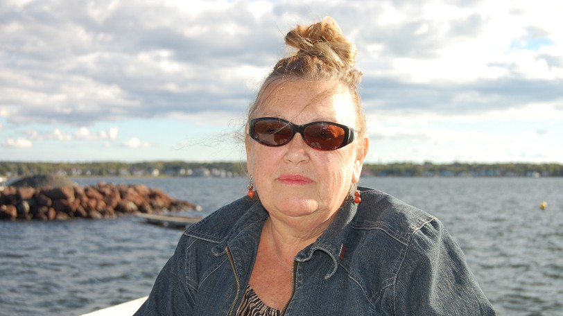 Odette Babineau, chair of the local service district advisory committee for Pointe-du-Chêne, pictured Monday on the wharf on Shediac Bay, says the province should slow down its local governance reform process.