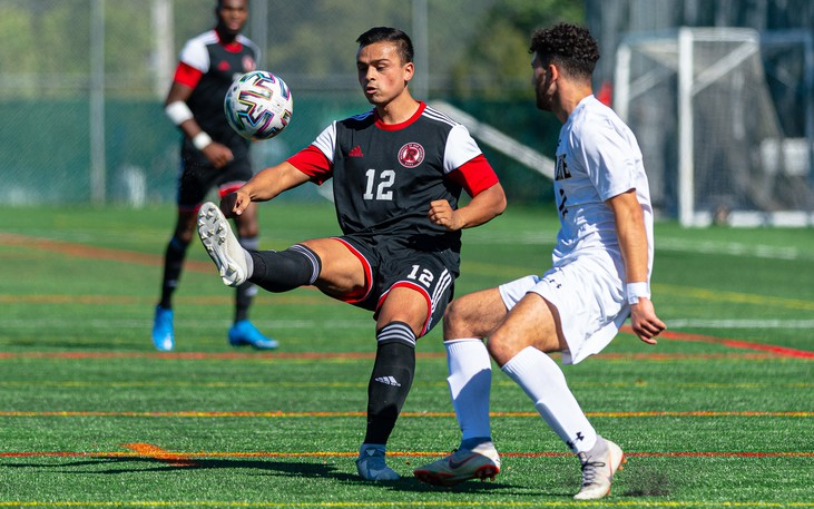 UNB's Matt Boem plays the ball away from a Dal attacker during Saturday's 1-0 road win. The Reds play Cape Breton on Saturday and St. FX on Sunday, both 3:15 p.m. starts at Scotiabank Park North turf field.