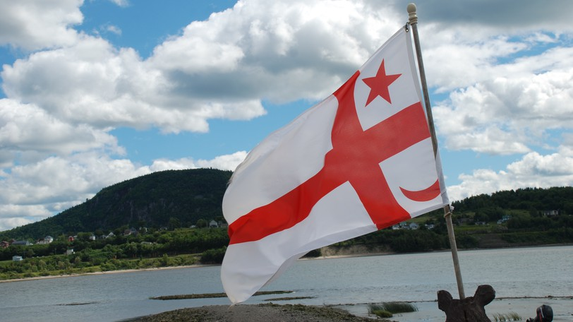 The flag of the Mi'gmaq Grand Council flying in Listuguj First Nation, across the Restigouche River from Campbellton. Both Campbellton and Dalhousie have joined the New Brunswick municipalities which will mark Sept. 30 as a national Day for Truth and Reconciliation, even though the province will not make it a statutory holiday.