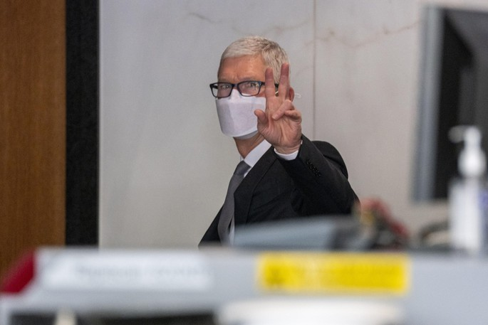 Tim Cook, chief executive officer of Apple, gestures while exiting U.S. district court in Oakland, Calif., on May 21, 2021.