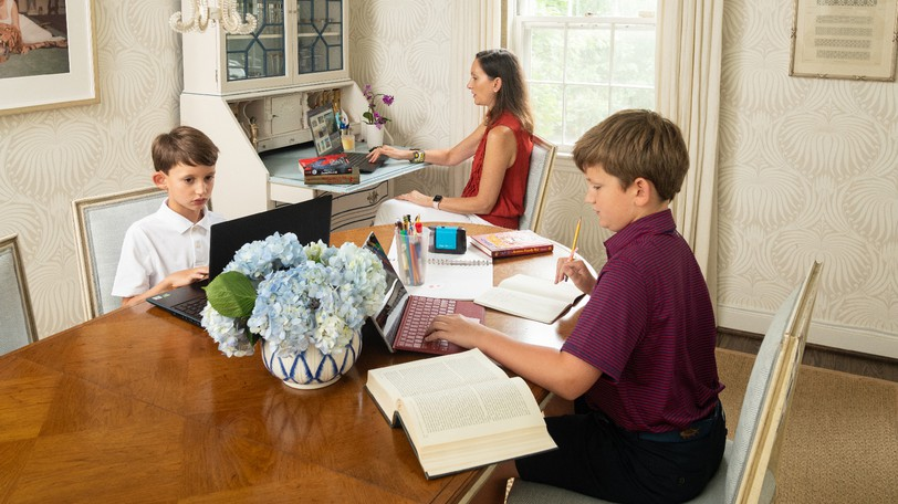 Interior designer Marika Meyer (with sons Grayson, 11, and Colin, 8) has turned her old dining room into a family game room and now utilizes a larger space as her family's mixed-use dining area. MUST CREDIT: Photo for The Washington Post by Mike Morgan
