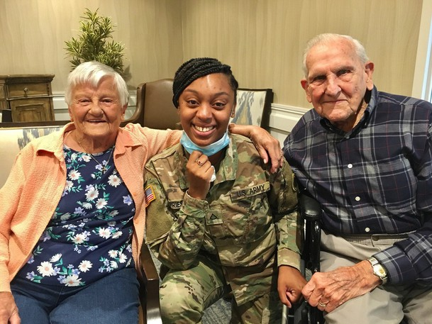 Delores Grasberger, 93, with her husband and Dashauna Priest. The Grasbergers say they consider Priest to be a third daughter to them.
