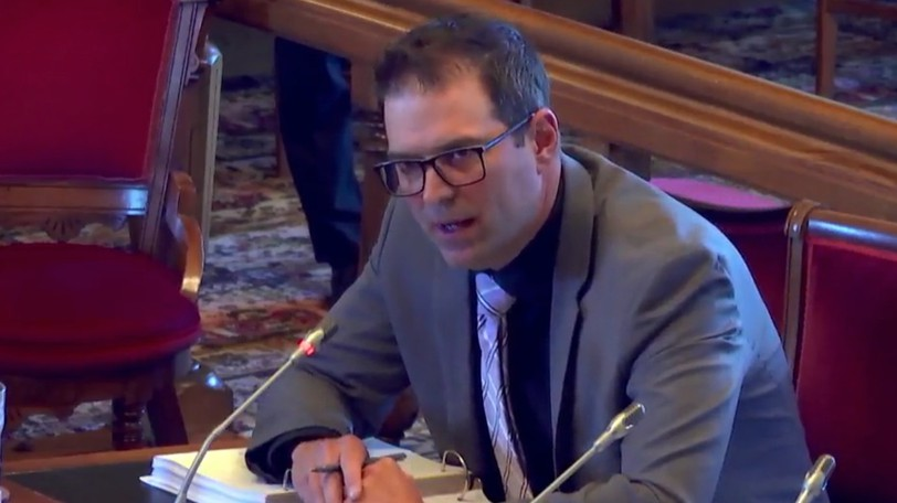 Cade Libby, New Brunswick's deputy minister of Aboriginal Affairs, Environment and Climate Change, and Intergovernmental Affairs fields questions at a legislative committee on Tuesday. Libby is also the president of the Regional Development Corporation.