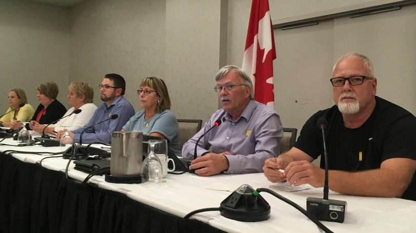 """CUPE New Brunswick president Steve Drost, pictured second from right at a media conference in Moncton on Tuesday, announced three locals have returned """"overwhelmingly strong"""" votes in favour of strike action."""
