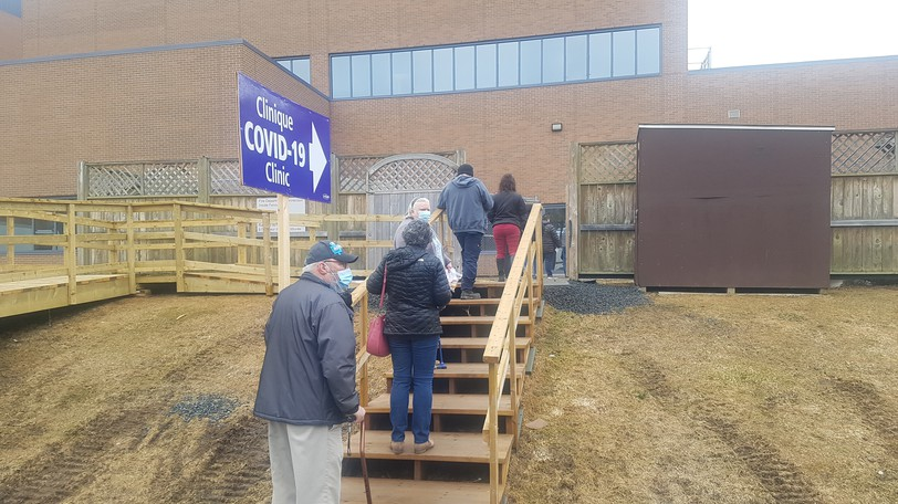 People line up for COVID-19 vaccinations at Campbellton Regional Hospital in April. Following the lead of other municipalities, the city of Campbellton will make such vaccinations mandatory for staff, council, and contractors doing business with the city.
