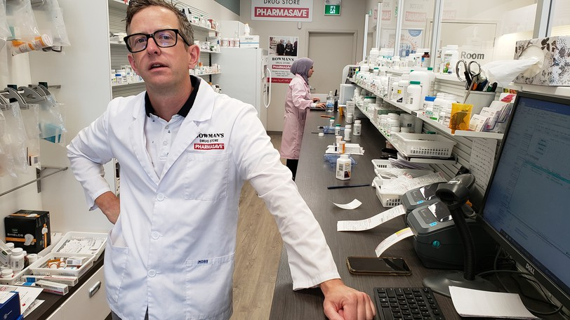 Pharmacist Paul Bowman of Fredericton, who took his mask off for the photo, says he hopes to be able to give a client a flu and COVID-19 vaccination at the same time.